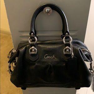 Black coach bag. Purple lining